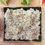 Sushi rice covering a nori sheet
