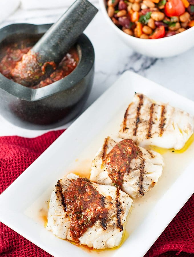 Grilled cod loins with Portuguese garlic sauce