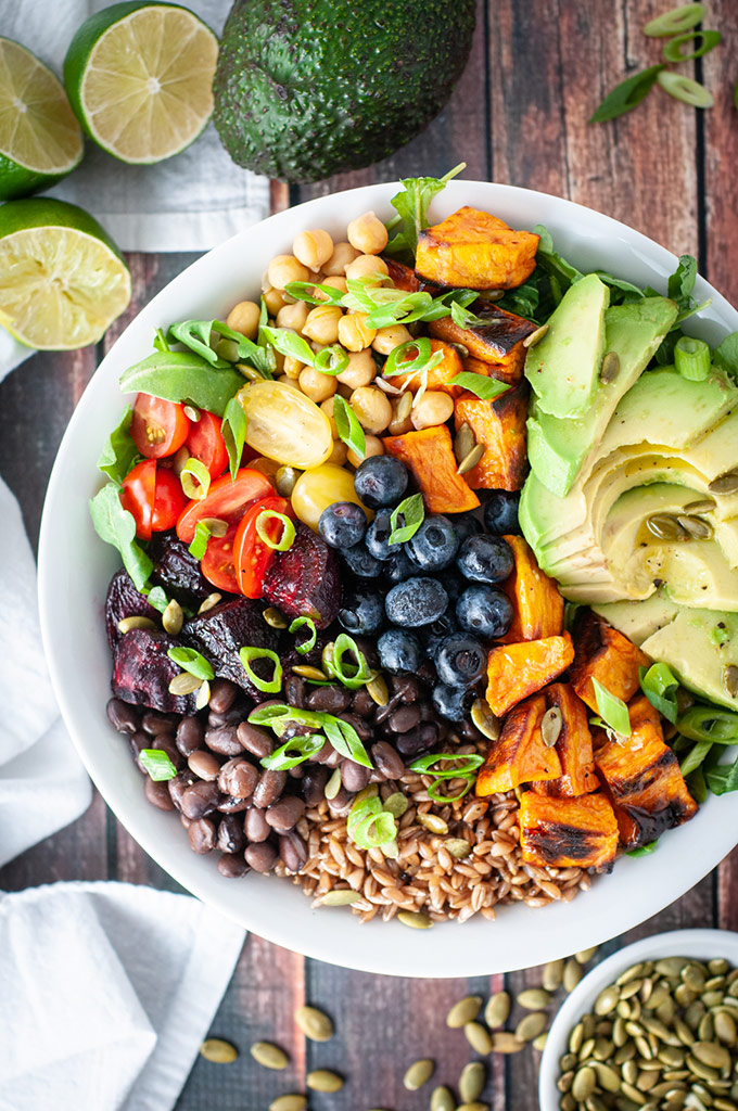 Power bowl with farro, avocado, legumes and veggies