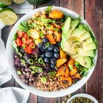 Power bowl with farro, avocado, legumes and veggies