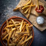 French fries on a red plate