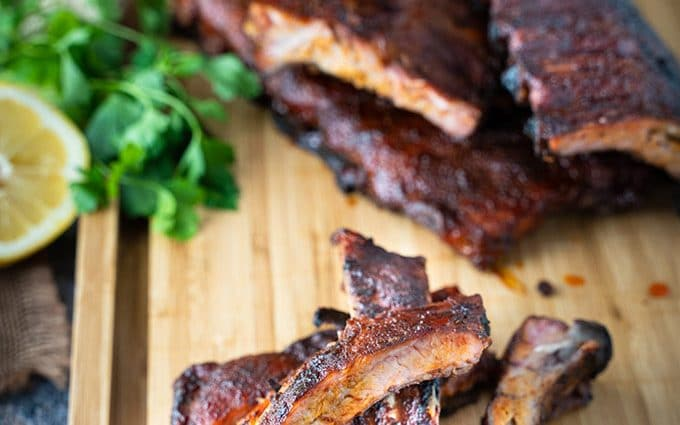 Aaron Franklin-style smoked back ribs on a pellet smoker and grill