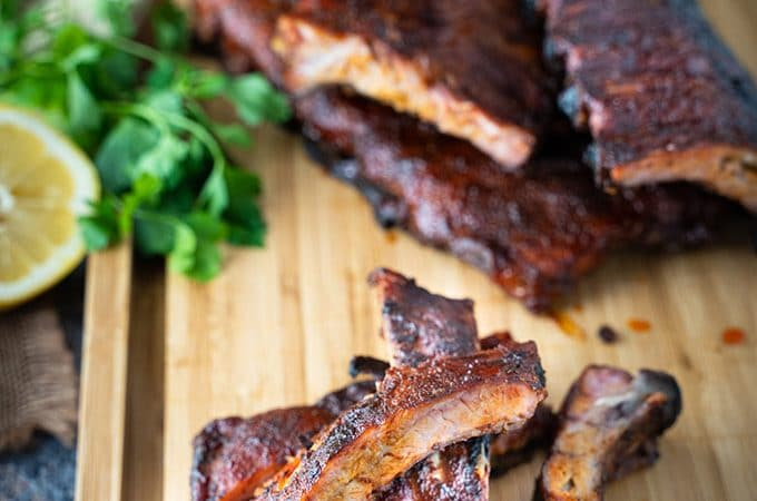 Smoked back ribs on a cutting board