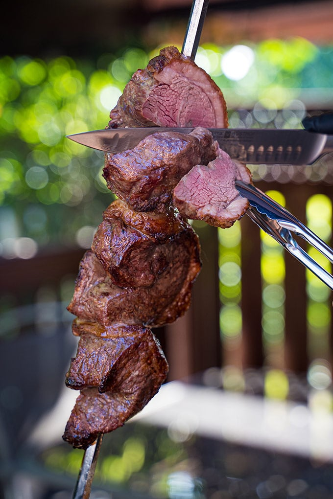 Picanha pieces on a rotisserie spit