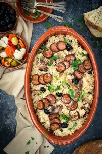 Portuguese duck rice - arroz de pato in a red clay baking dish