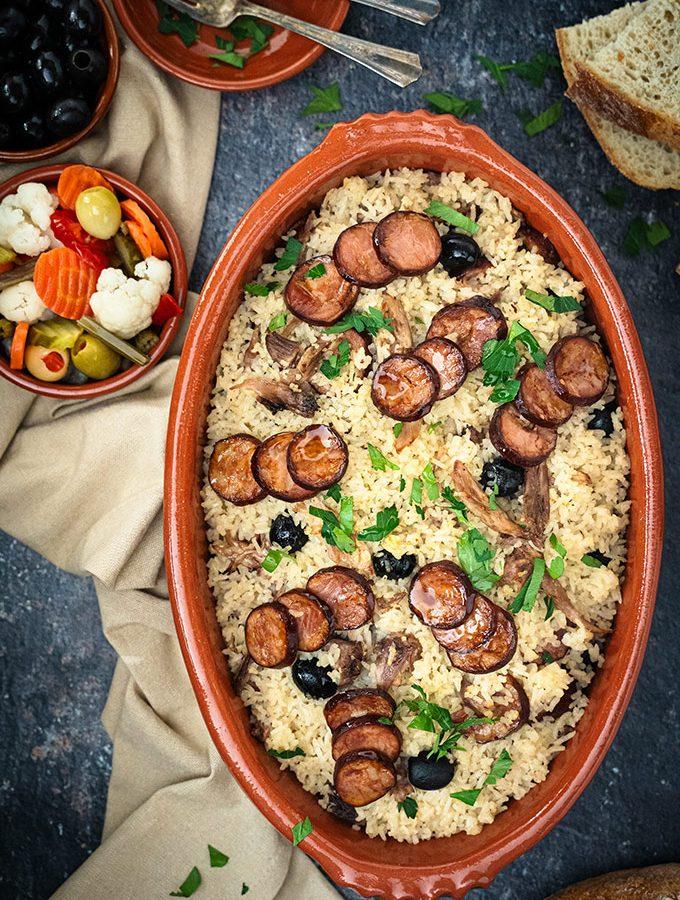 Portuguese duck rice - arroz de pato in a red clay baking dish