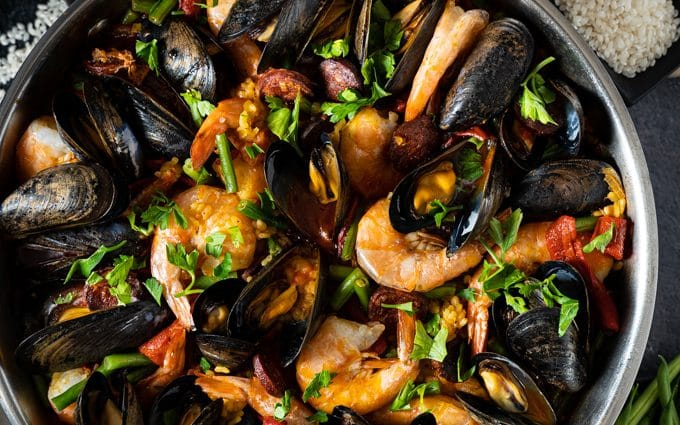 Paella with chicken, chorizo and seafood