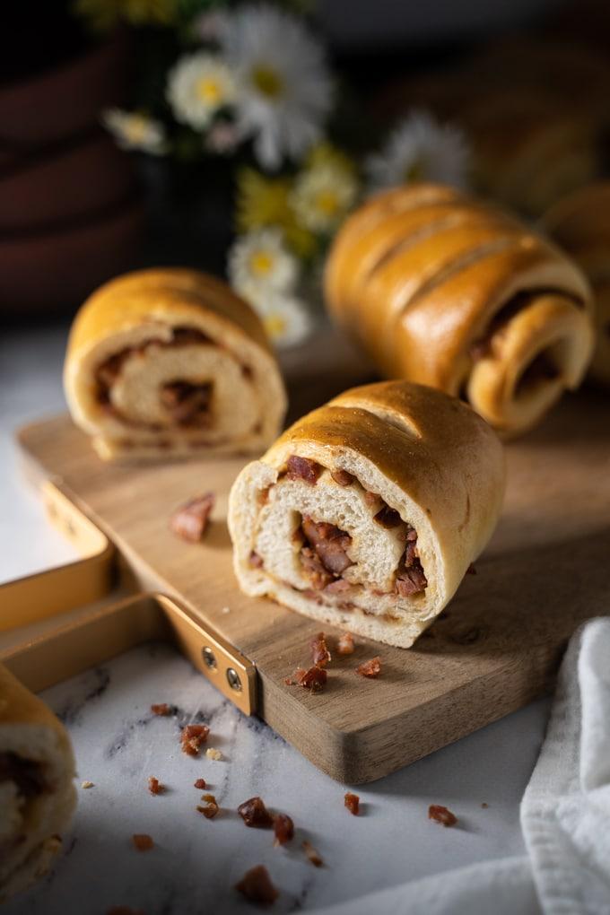 Portuguese chouriço buns or Pão com chouriço on a cutting board