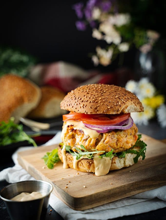 salmon burger on a cutting board